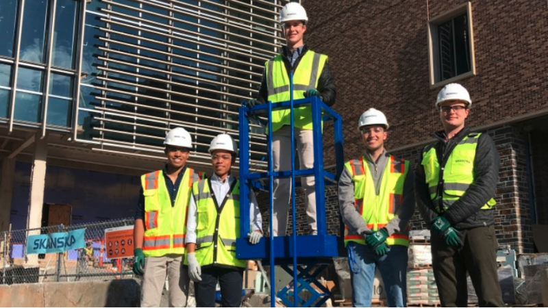 group of people in front of new building